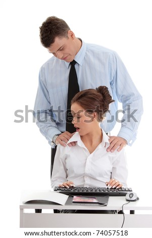 harassment at work concept. Man harassing a woman - stock photo