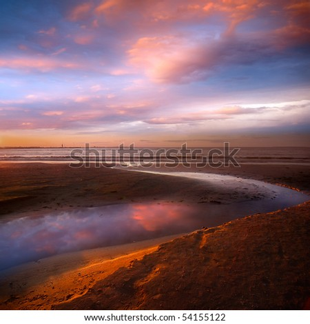 Harbor and beautiful sandy beach An Evening - stock photo
