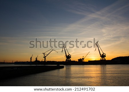 Harbor cranes at sunset. Image taken in Gothenburg, Sweden