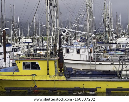 Harbor full of commercial and charter fishing vessels on a stormy day in Garibaldi, Oregon, USA - stock photo