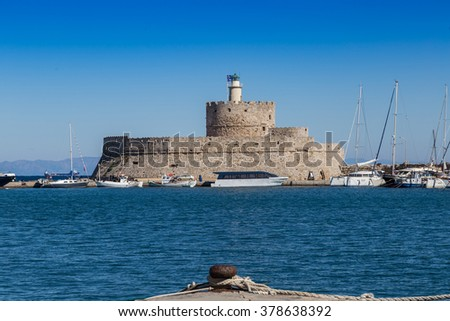 Harbor lighthouse and boats, Rhodes Greece