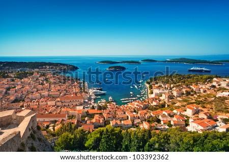 Harbor of old Adriatic island town Hvar. High angle panoramic view. Popular touristic destination of Croatia. - stock photo
