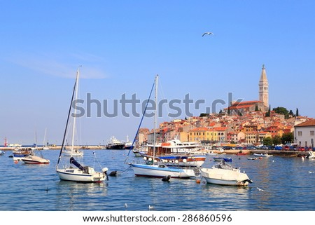 Harbor of old Venetian town with a group of sail boats at anchor, Rovinj, Croatia - stock photo