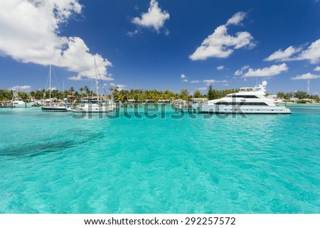 Harbor on tropical island with turquoise water and blue sky