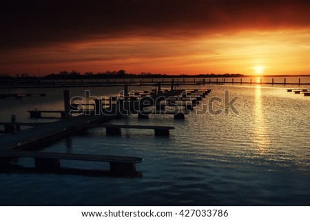 Harbor without ships at sunset