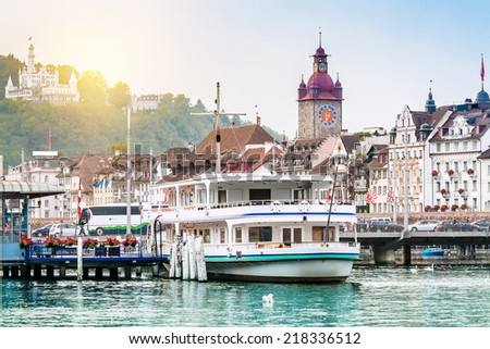 Harbour and buildings in city center in Lucerne, Switzerland - stock photo