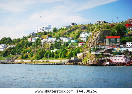 Harbour front village in St. John's - stock photo