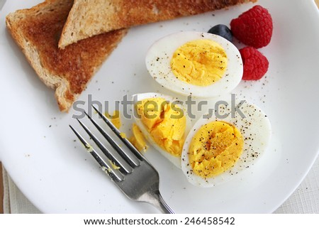 Hard boiled egg breakfast with salt and pepper. - stock photo