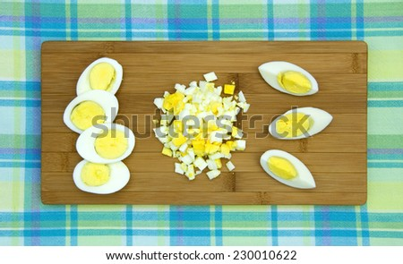 Hard boiled eggs on a wooden board  - stock photo