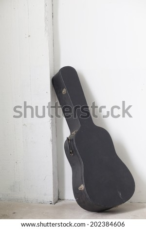 hard case for old guitar - stock photo