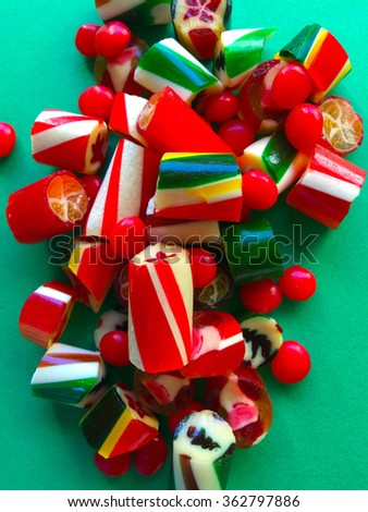 Hard Christmas candies on green background - stock photo
