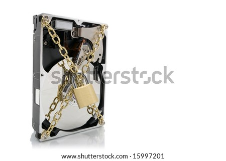 Hard disk device wrapped with chains and padlock - stock photo