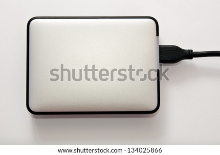 hard disk on a gray background closeup - stock photo