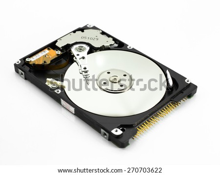 Hard disk read head closeup on a blue background - stock photo