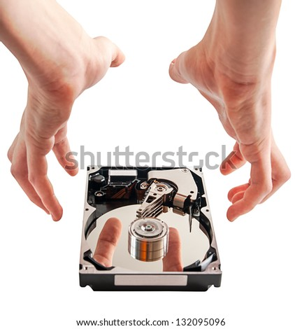 Hard drive details and hands, concept of data security, on a white background - stock photo