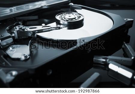 Hard drive or hard disc on black reflex background - stock photo