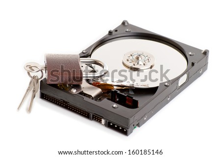 Hard drive with a lock and key isolated on white background - stock photo