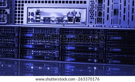 Hard drives in data center storing information. - stock photo