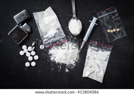 Hard drugs on dark table