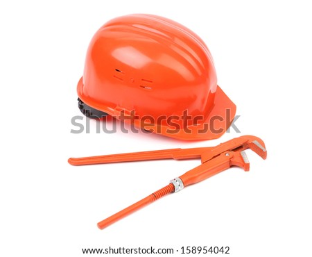 Hard hat and wrench close up. Isolated on a white backgropund.