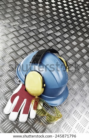 hard-hat, helmet, gloves, protective industrial clothing - stock photo