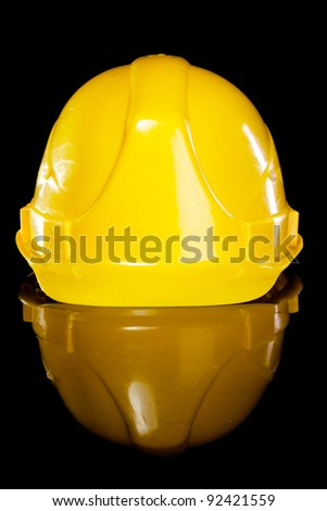 Hard hat isolated on a black background - stock photo