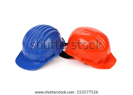 Hard hat of different colors like yin and yang. - stock photo