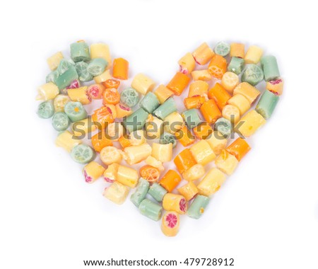 Hard home made all natural candies hearth shape on white background