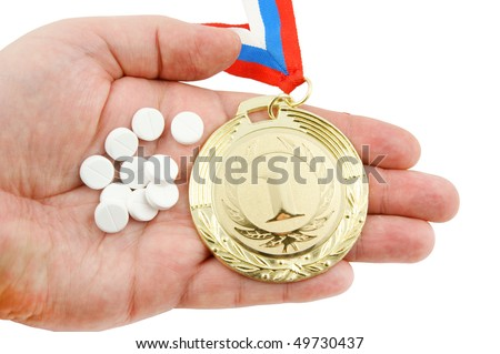 Hard life in sport concept, gold medal and tablets on hand isolated - stock photo
