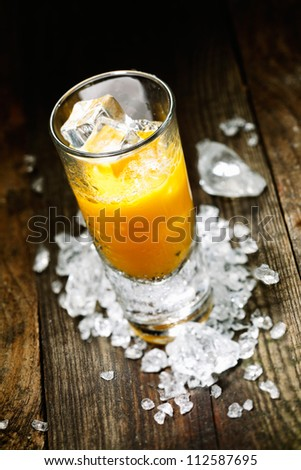 Hard Liquor Orange Juice Shooter on a countertop with crushed ice and alcohol for drink concepts look at my portofolio