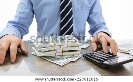 Hard money lender / close-up photo of successful boss working with calculator in the office  - stock photo