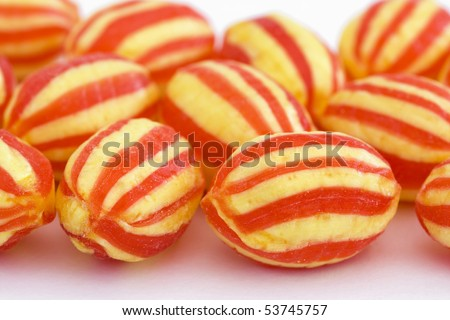 hard stripy sweets on a white background - stock photo