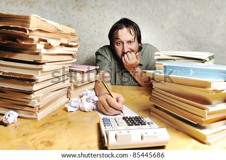 Hard work, businessman accounting at the office - stock photo