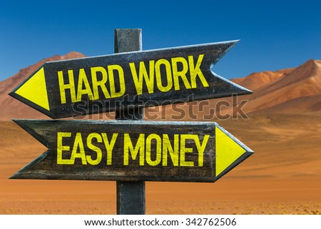 Hard Work - Easy Money signpost in a desert background - stock photo