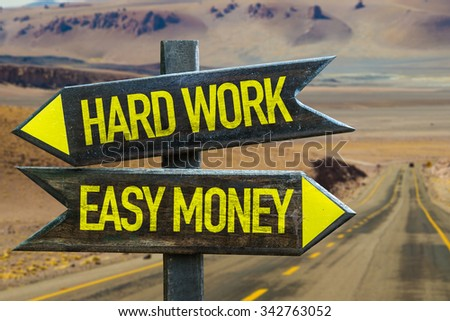 Hard Work - Easy Money signpost in a desert road on background - stock photo