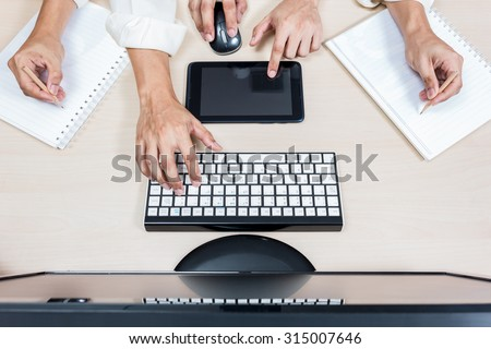 hard working asian businessman / male employee hands with computer on workspace desk in office - stock photo
