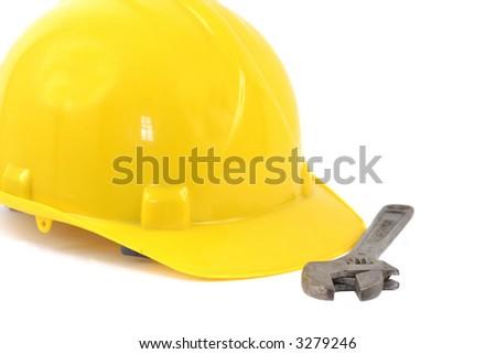 Hardhat And Monkey Wrench - stock photo