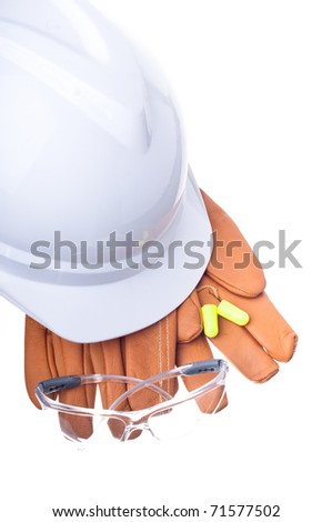 hardhat, gloves, safety glasses, and earplugs - stock photo