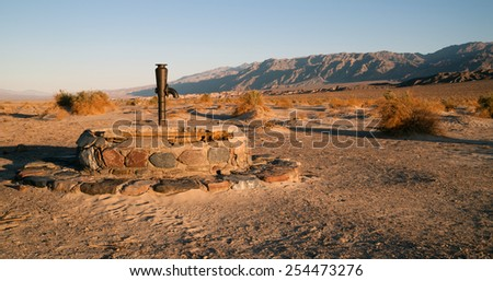 Hardware from a historic well still lives in Death Valley National Park - stock photo