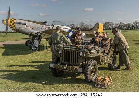 HARDWICK AIRFIELD, NORFOLK, UK - APRIL 18 - The airfield hosts a unique photographic event with restored military aircraft and volunteers reenacting scenes from WW2. 18 April 2015 in Norfolk. - stock photo
