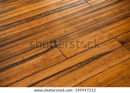 Hardwood flooring from eco friendly bamboo with hand scrapped finish - stock photo