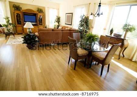 Hardwood Flooring in a large open plan home featuring casual dining area and den