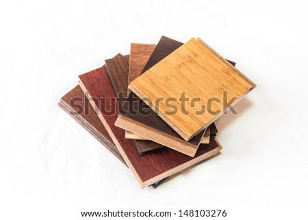 Hardwood flooring samples including maple, oak, bamboo and cork - stock photo