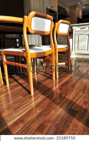 Hardwood walnut floor in residential home dining room - stock photo