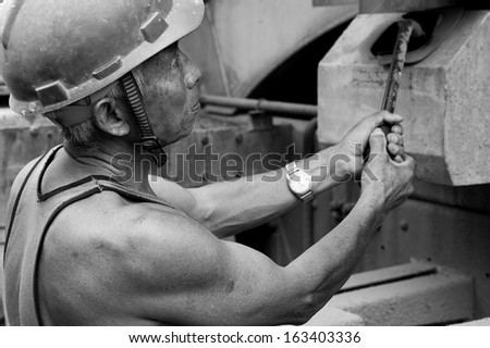 hardworking laborer on construction site - stock photo