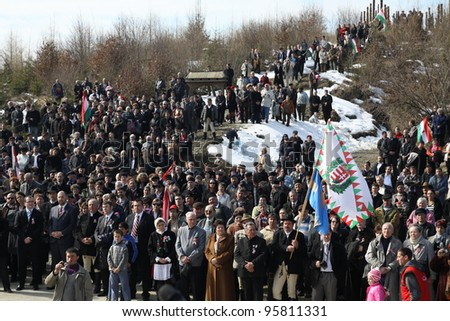 HARGITA, ROMANIA - MARCH 15: Crowd at commemoration of 163nd anniversary of the Hungarian Revolution on 15th of March, 2011 in Hargita, Romania - stock photo