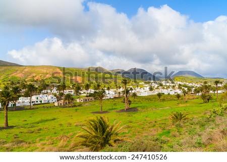 Haria village in tropical mountain landscape of Lanzarote island, Spain - stock photo
