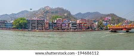 HARIDWAR, INDIA - APRIL 15, 2010: Buildings and hotels on the banks of the river Ganges in time of Kumbh Melam. - stock photo