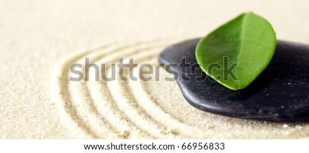 harmony concept with zen stones and leaves - stock photo