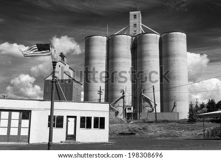 Harrington, Washington, USA. A black and white view of this rural Palouse town in eastern Washington state. Silos and American flags are the order of the day here.  - stock photo
